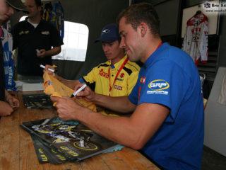 Teammates signing autographs